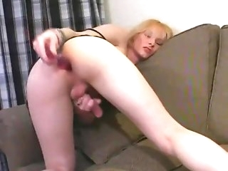 Blonde shemale has dildo insertion in her ass